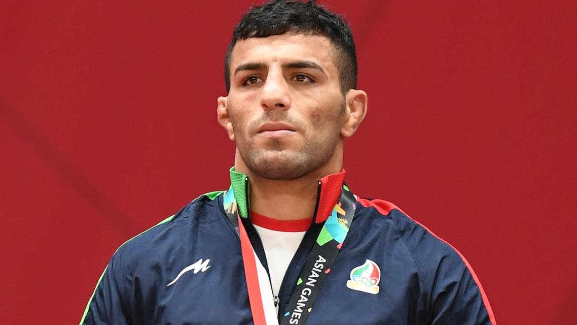 Iran's Saeid Mollaei poses with his gold medal during the podium ceremony for the men under 81kg category of the 2018 Judo World Championships in Baku. (File Photo: Reuters)