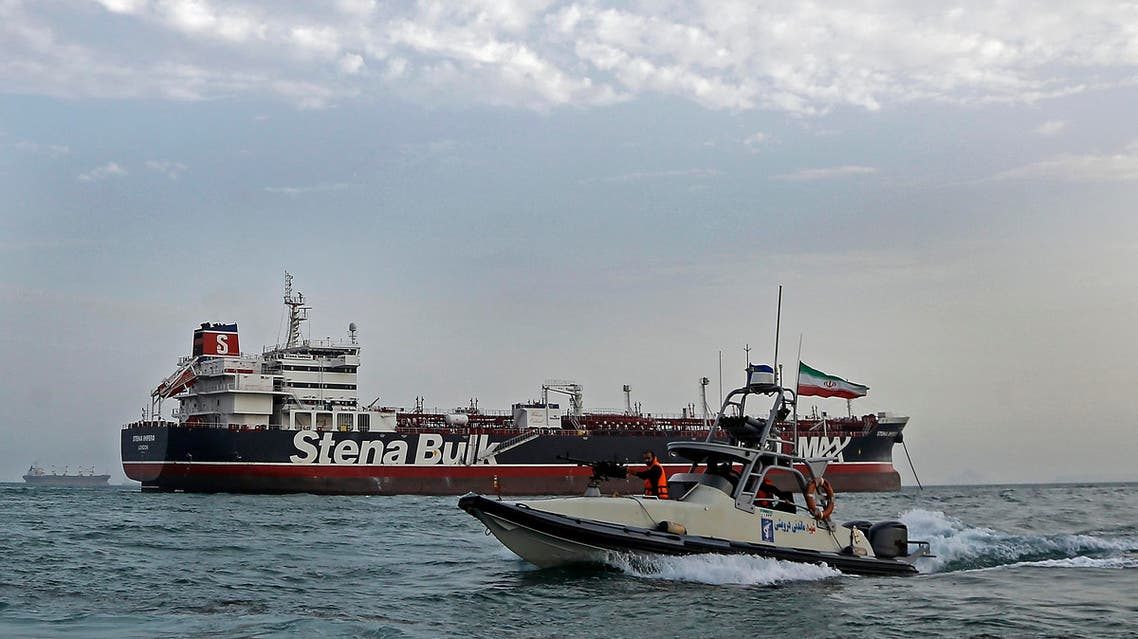 A speedboat of the Iran's Revolutionary Guard moves around a British-flagged oil tanker Stena Impero, which was seized on Friday by the Guard, in the Iranian port of Bandar Abbas, Sunday, July 21, 2019. (AP)