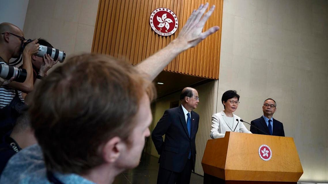 Hong Kong Chief Executive Carrie Lam (second from right), speaks during a press conference at the government building in Hong Kong, on September 5, 2019. (AP)