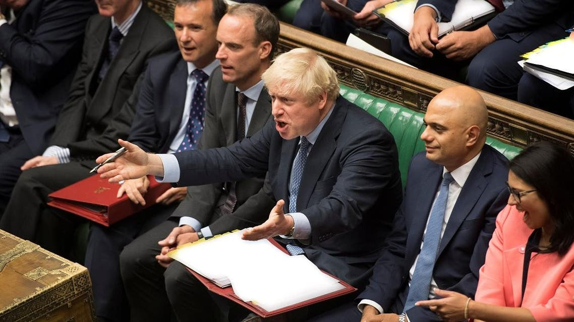Britain's Prime Minister Boris Johnson gestures during PMQs session in the House of Commons in London. (Reuters)