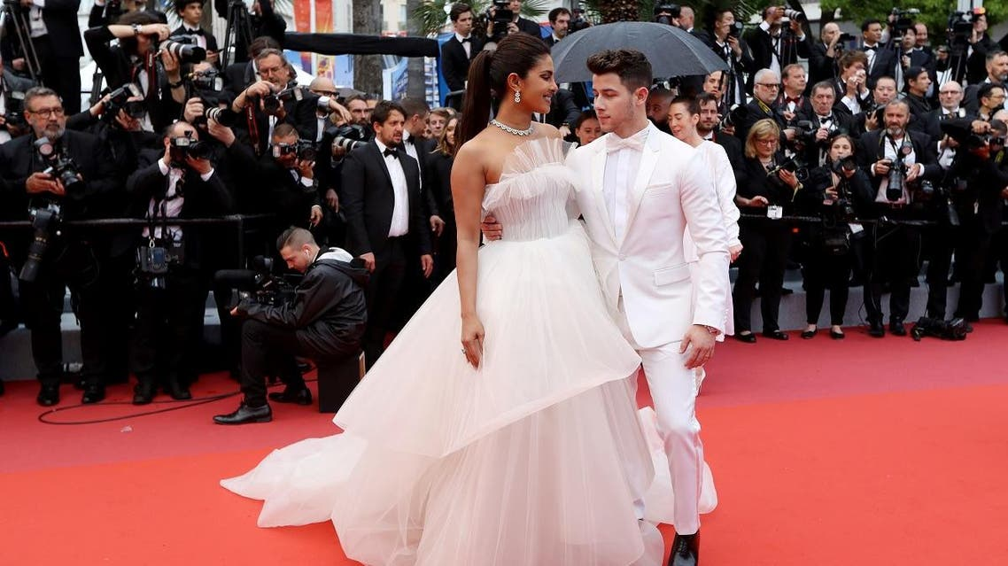 """Indian actress and model Priyanka Chopra (L) and US singer songwriter Nick Jonas arrive for the screening of the film """"The Best Years of a Life (Les Plus Belles Annees D'Une Vie)"""" at the 72nd edition of the Cannes Film Festival in Cannes, southern France, on May 18, 2019. (AFP)"""