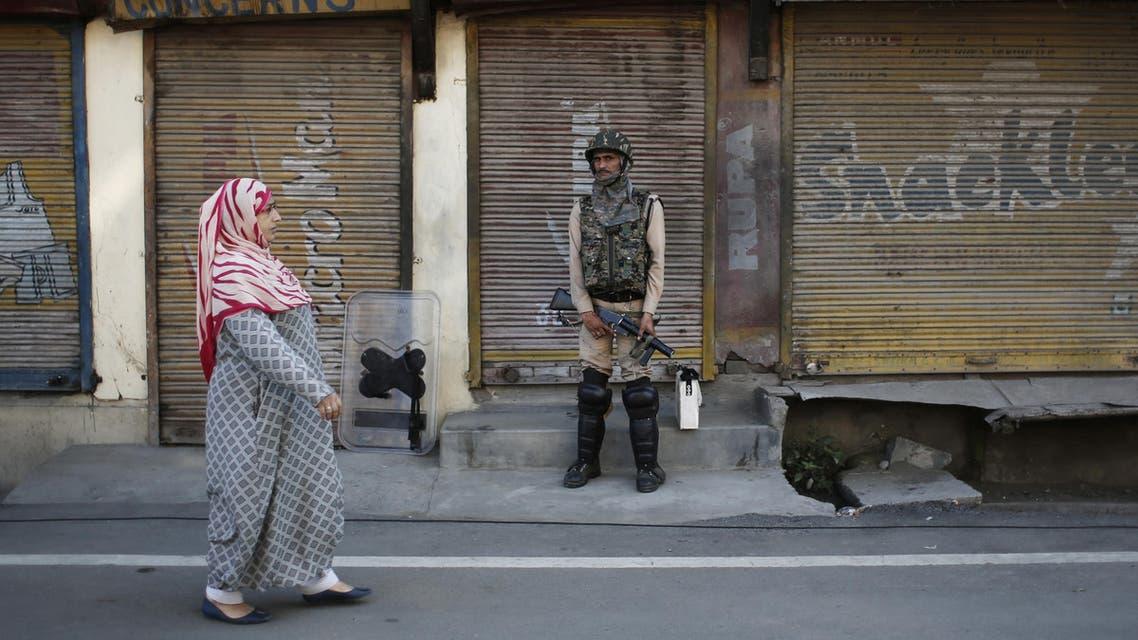 Kashmir Indian soldier woman street - Reuters