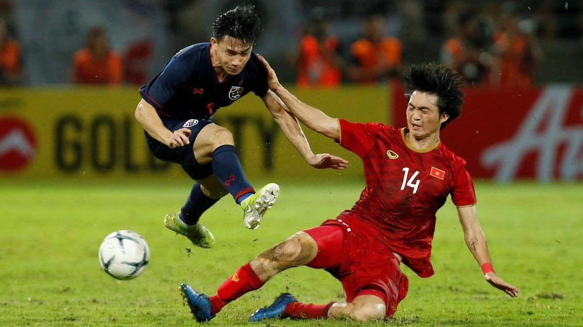 Vietnam's Nguyen Tuan Anh (R) in action against Thailand in the  2022 World Cup held at Thammasat University Main Stadium, Rangsit, Pathum Thani, Thailand, on September 5, 2019.  (Reuters)