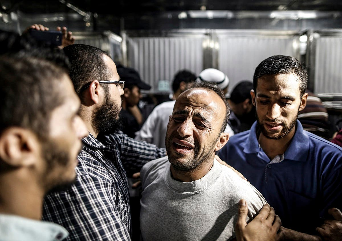 The father of Palestinian Khaled al-Rabaee who was killed during clashes following a demonstration at the Israeli-Gaza border fence, reacts at al-Shifa hospital in Gaza City on September 6, 2019. (AFP)