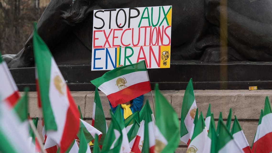 Stop executions in Iran protest in France flag - AP