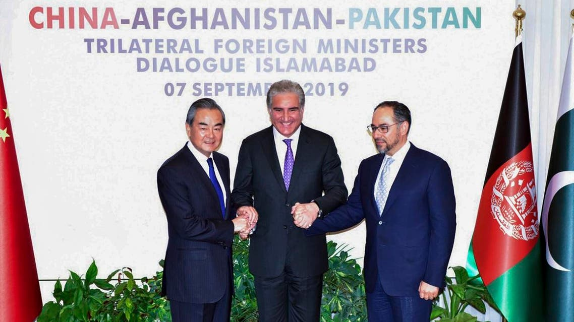 Pakistan Foreign Minister Shah Mahmood Qureshi (C) and Chinese Foreign Minister Wang Yi (L) along with Afghanistan Foreign Minister Salahuddin Rabbani (R) in Islamabad. (AFP)