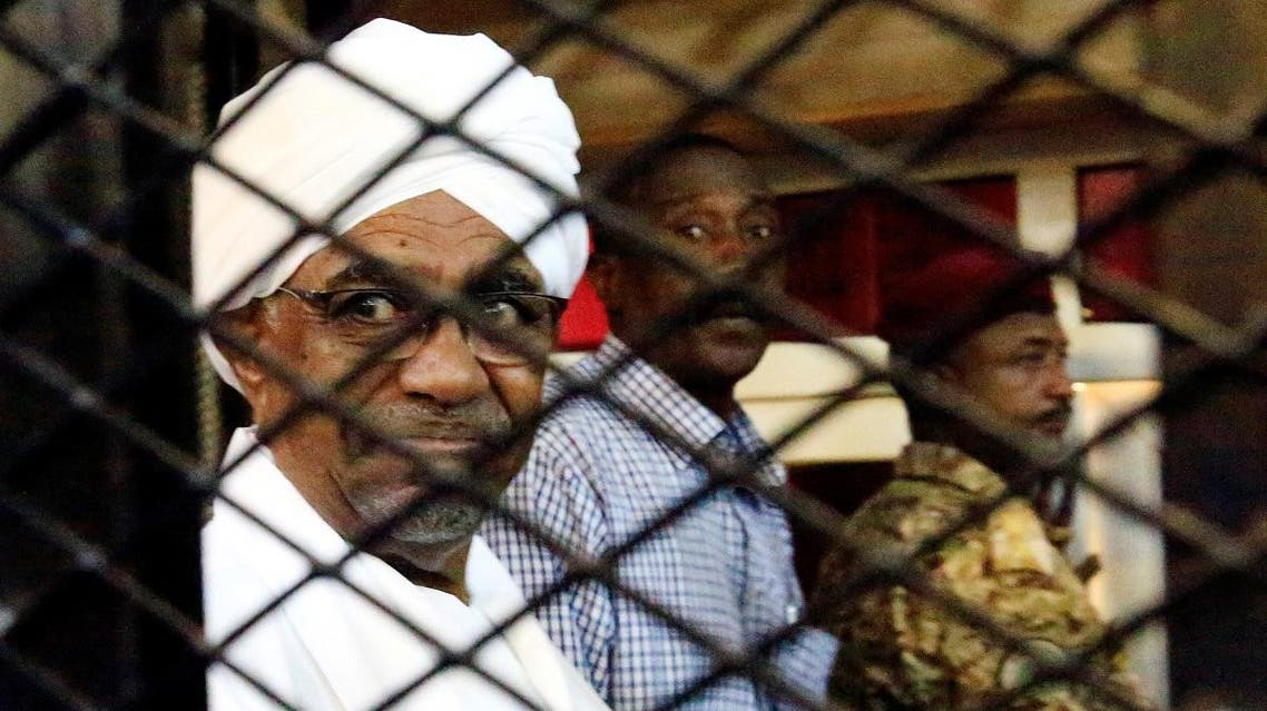 Sudan's former president Omar Hassan al-Bashir sits inside a cage at the courthouse where he is facing corruption charges, in Khartoum, Sudan August 31, 2019. REUTERS