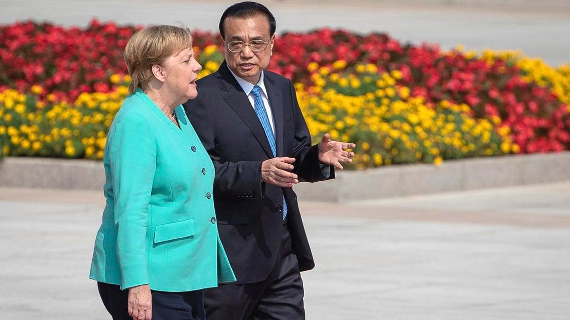 Chinese Premier Li Keqiang (right), and German Chancellor Angela Merkel attend a welcome ceremony at the Great Hall of the People in Beijing, on September 6, 2019. (AP)