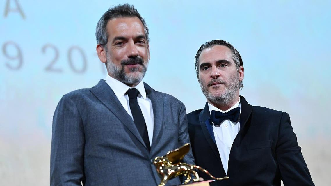 "US director Todd Phillips (L), flanked by US actor Joaquin Phoenix, holds the Golden Lion award for Best Film he received for the movie ""Joker"" during the awards ceremony of the 76th Venice Film Festival on September 7, 2019 at Venice Lido."