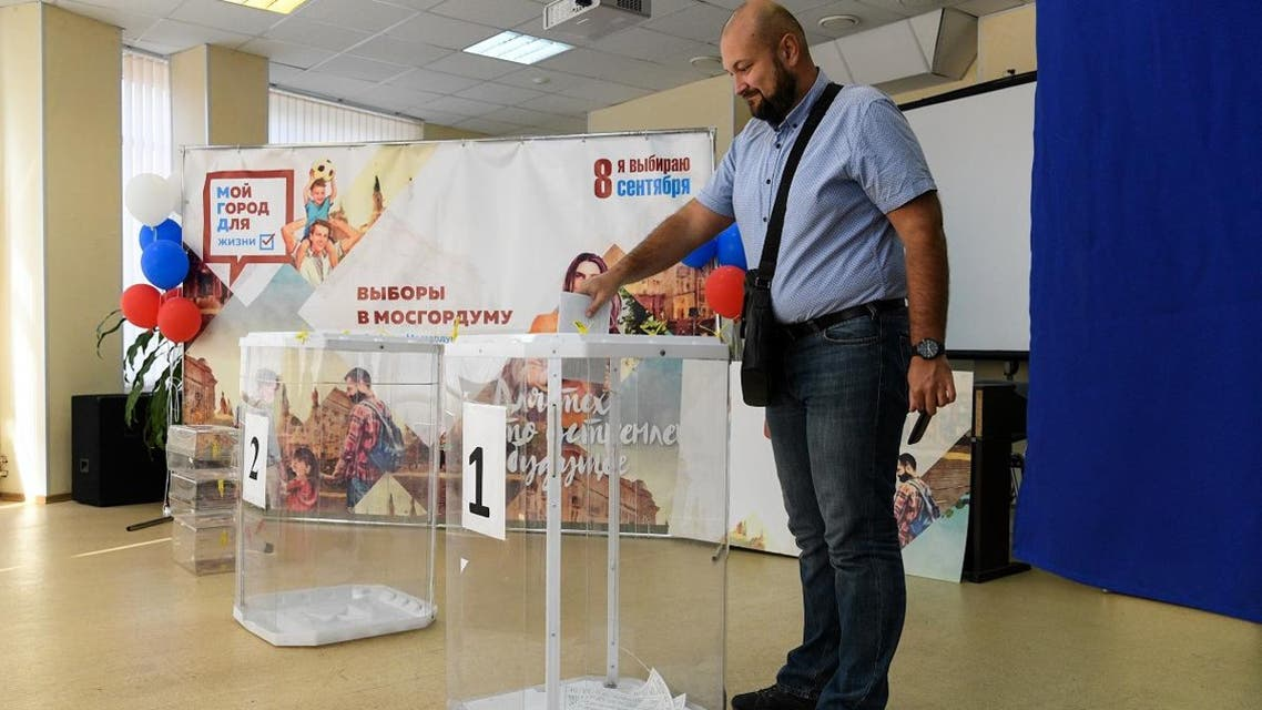 A man casts his vote at a polling station during to the Moscow city Duma election in Moscow on September 8, 2019. (AFP)