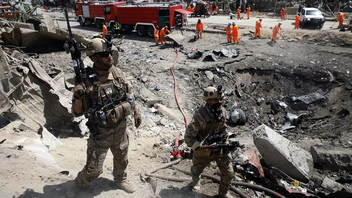 Afghan security forces walks as municipal workers gather to clean up near the crater from an attack at the Green Village in Kabul on September 3, 2019. (File photo: AFP)
