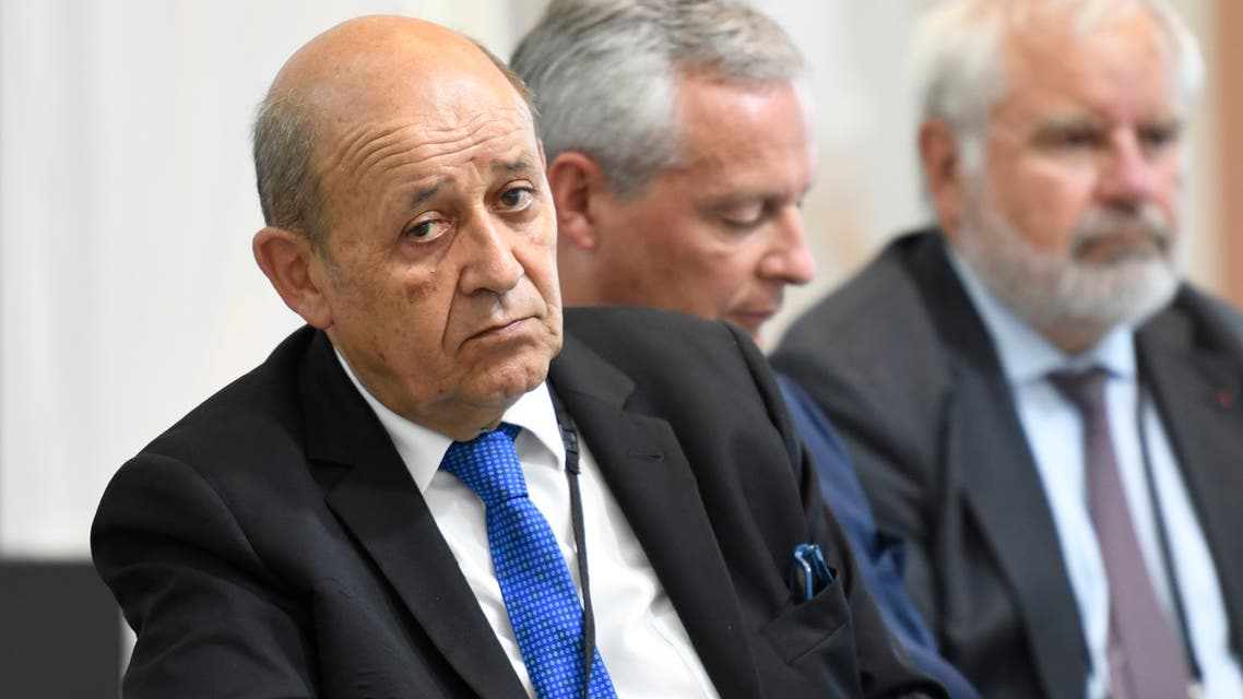 French Foreign Affairs Minister Jean-Yves Le Drian attend a French president's press conference in Biarritz, south-west France on August 26, 2019, on the third day of the annual G7 Summit attended by the leaders of the world's seven richest democracies, Britain, Canada, France, Germany, Italy, Japan and the United States.