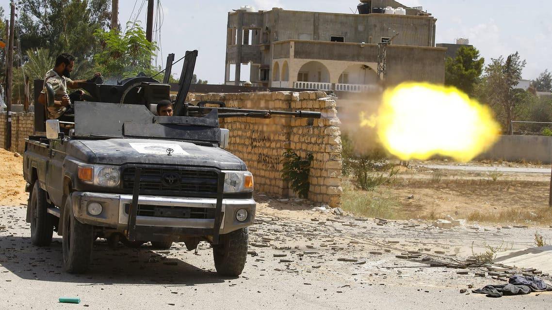 A fighter loyal to the internationally recognised Libyan Government of National Accord (GNA)fires a truck-mounted gun during clashes with forces loyal to strongman Khalifa Haftar in the capital Tripoli's suburb of Ain Zara, on September 7, 2019.