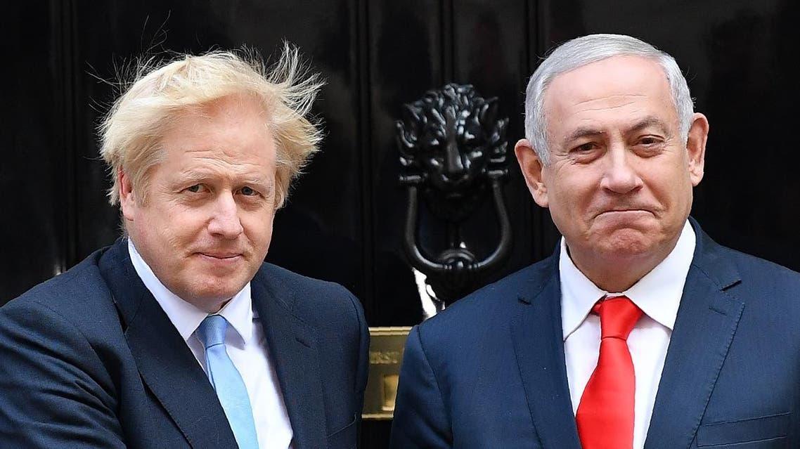 Britain's Prime Minister Boris Johnson (L) greets Israel's Prime Minister Benjamin Netanyahu outside 10 Downing Street in central London on September 5, 2019. (AFP)