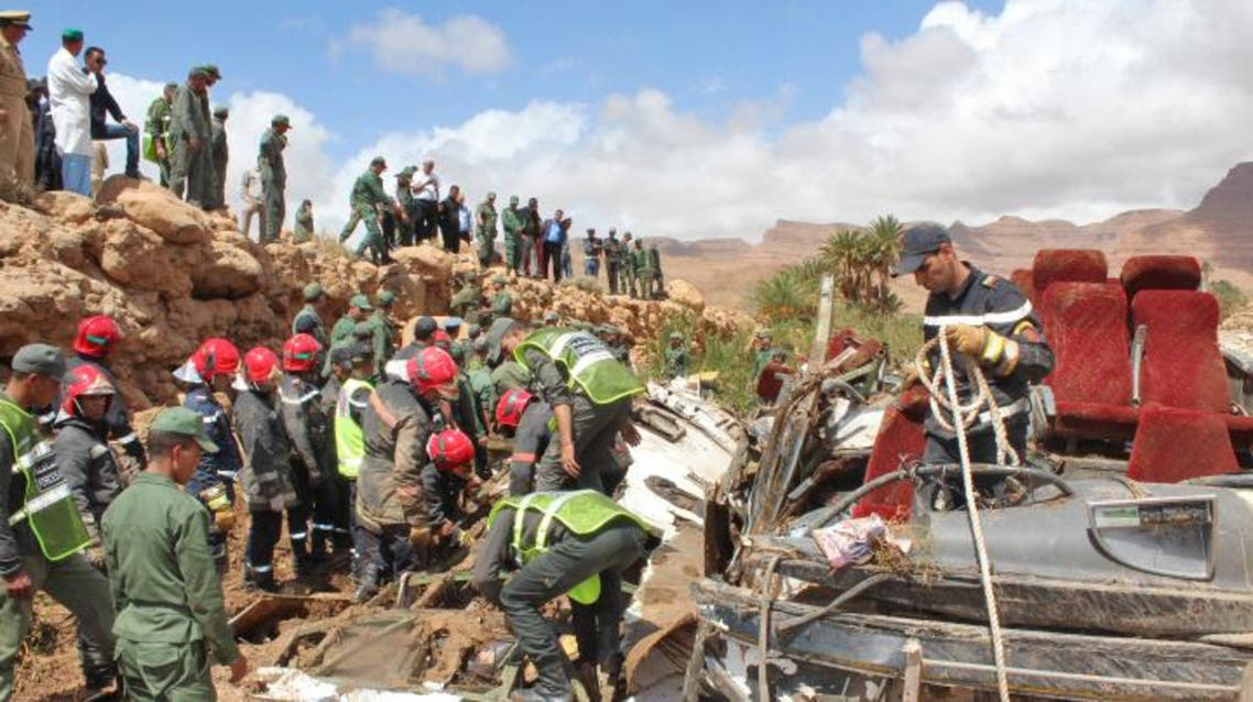 Members of the security forces search for bodies in the wreckage of bus at the banks of the Damchan river near the city of Errachidia, in the El Khank region in southern Morocco following a flood-related accident that left at least six people dead, on September 8, 2019. (AFP)