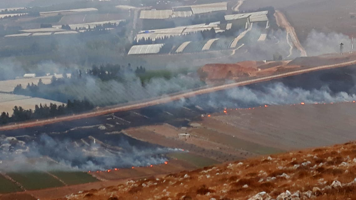 This picture taken on September 1, 2019 from a location near the southern Lebanese village of Maroun al-Ras, close to the border with Israel, shows smoke rising from fires along the border with Israel on the Lebanese side following an exchange of fire. Israel and Hezbollah exchanged fire along the Lebanese border on September 1 after a week of rising tensions, but no casualties were reported following the brief flare-up and UN officials immediately urged restraint.