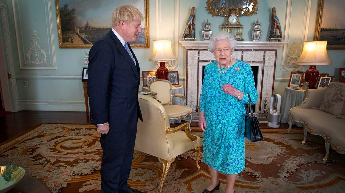 Britain's Queen Elizabeth II welcomes newly elected leader of the Conservative party, Boris Johnson during an audience in Buckingham Palace, London on July 24, 2019, where she invited him to become Prime Minister and form a new government. (AFP)