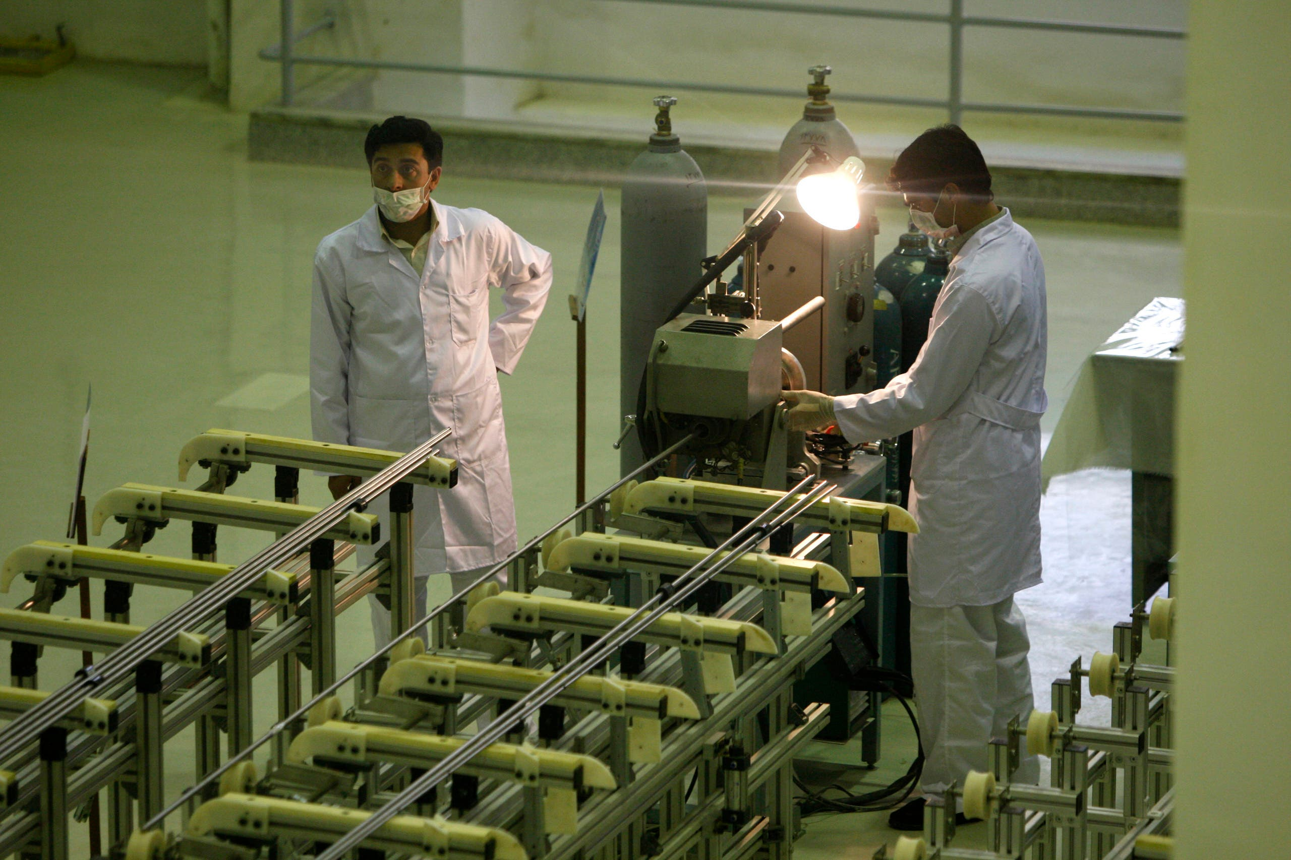 In this April 9, 2009 file picture Iranian technicians work at a new facility producing uranium fuel for a planned heavy-water nuclear reactor, just outside the city of Isfahan, 255 miles (410 kilometers) south of the capital Tehran. (AP)