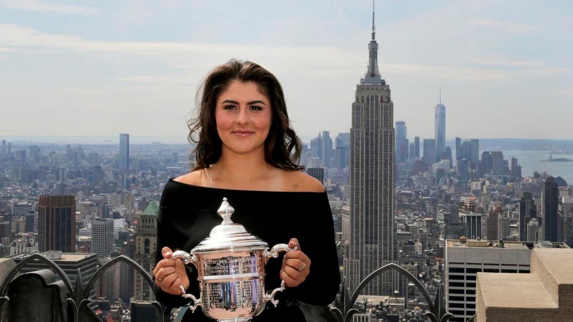 Bianca Andreescu poses with the US Open Women's singles championship trophy at Top of the Rock, on September 8, 2019, in New York. (AP)