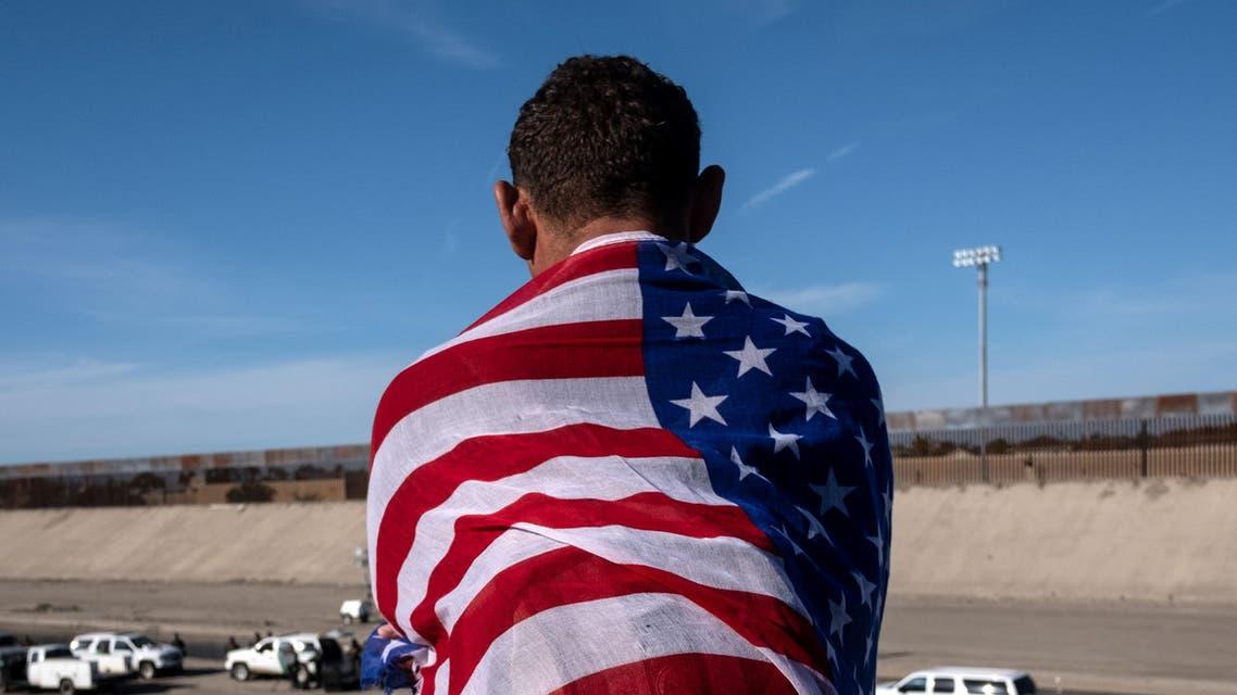 Honduras migrant in US flag - AFP