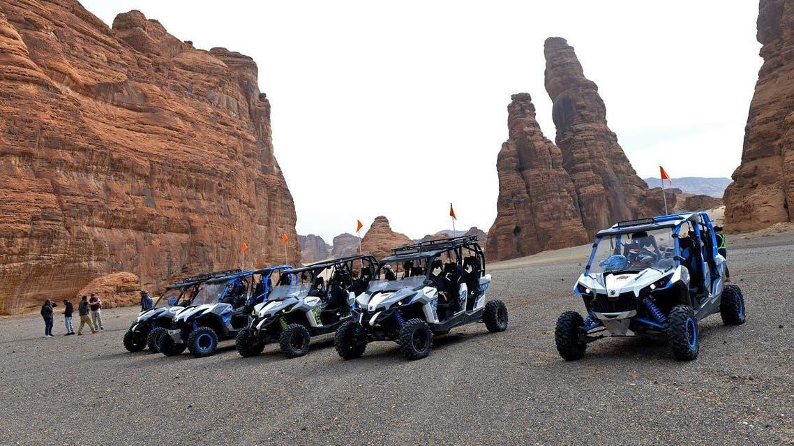 Tourists visit the Ula desert near the northwestern Saudi town of al-Ula, on January 5, 2019. (AFP)