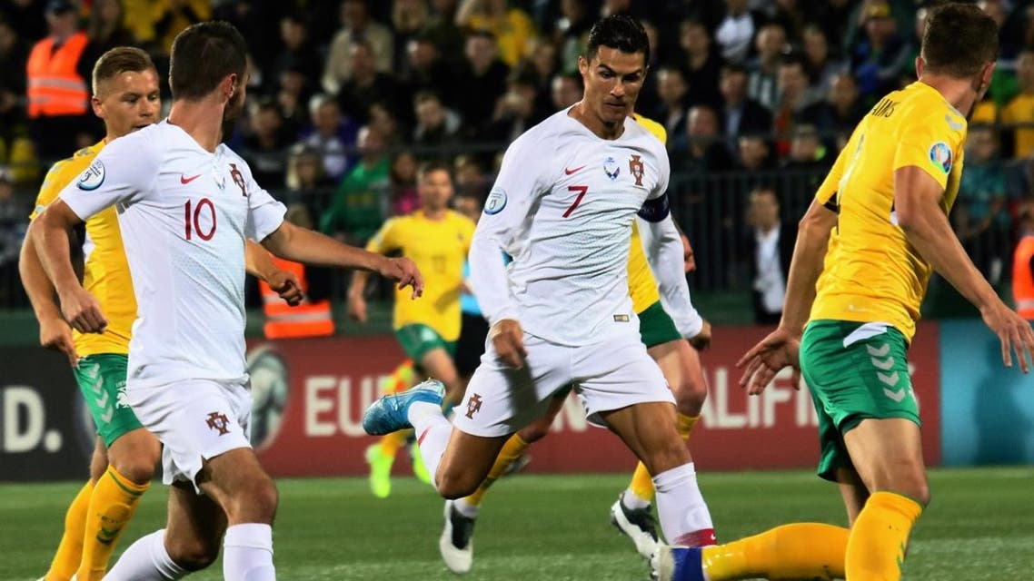 Cristiano Ronaldo (C) and Ruben Dias vies with Lithuania's Mantas Kuklys (R) during the UEFA Euro 2020 Group B qualification football match Lithuania v Portugal in Vilnius, Lithuania, on September 10, 2019. (AFP)