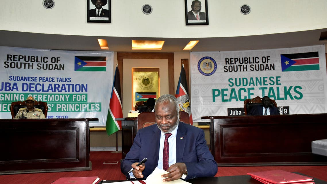 Dr. Gibril Ibrahim, the leader of Justice and Equality movement (JEM), signs the initial agreement on a roadmap for peace talks in Juba