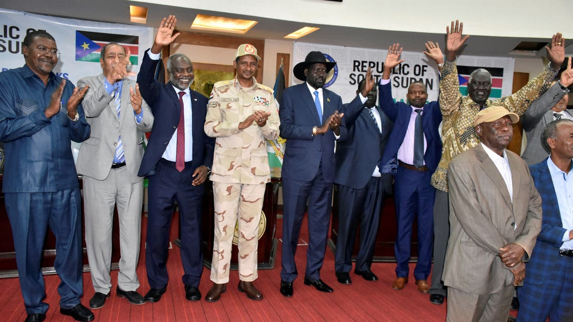 Sudanese officials, rebels and diplomats react after signing the initial agreement on a roadmap for peace talks in Juba