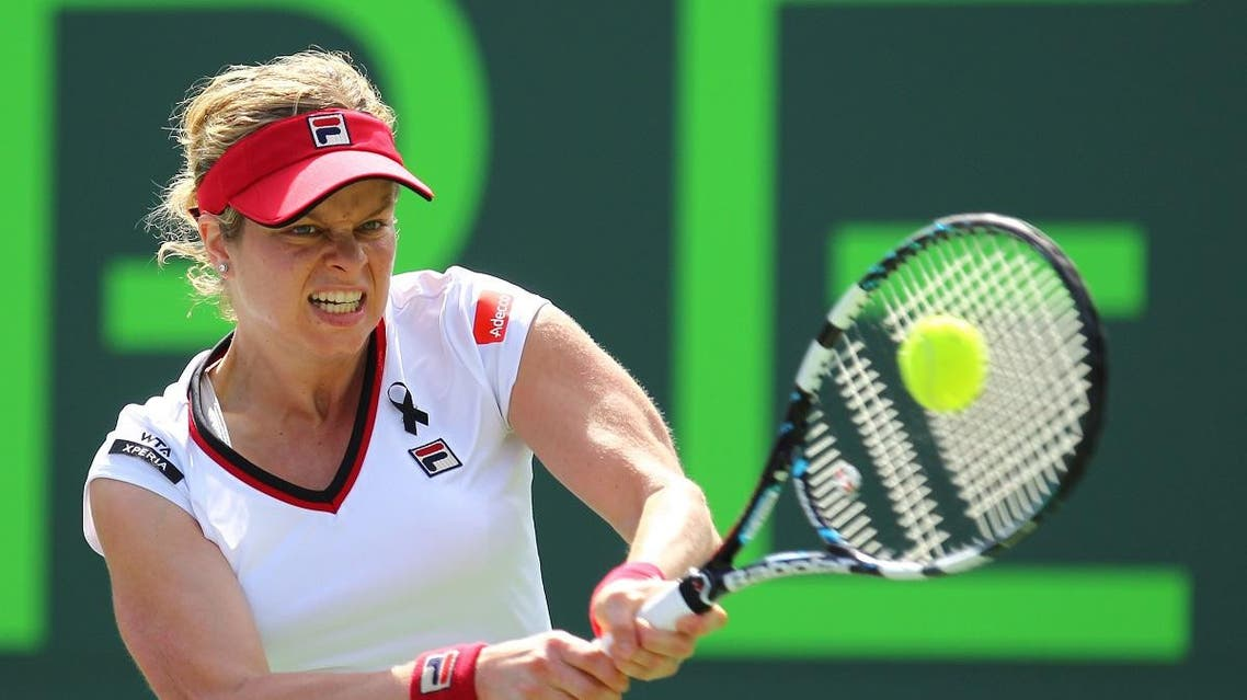 Kim Clijsters of Belgium returns the ball to Jarmila Gajdosova of Australia during Day 3 of the Sony Ericsson Open in 2012. (AFP)