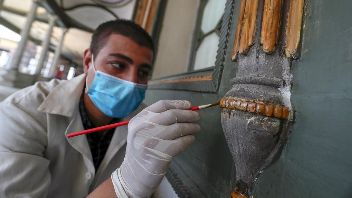 A worker paints a window frame during the restoration of Mohamed Ali Shubra Palace in the Egyptian capital Cairo. (AFP)