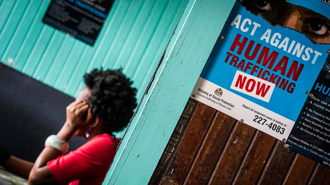 This photo made available by Interpol Monday April 30, 2018 shows a prostitute being questioned during a raid in night clubs in Georgetown, Guyana, on April 7, 2018. (AP)
