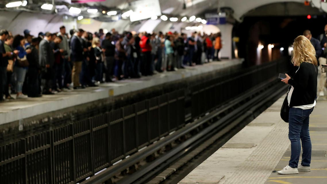 Commuters wait to board a metro at the Gare du Nord subway station during a strike by all unions of the Paris transport network (RATP) against pension reform plans in Paris, France, September 13, 2019. REUTERS