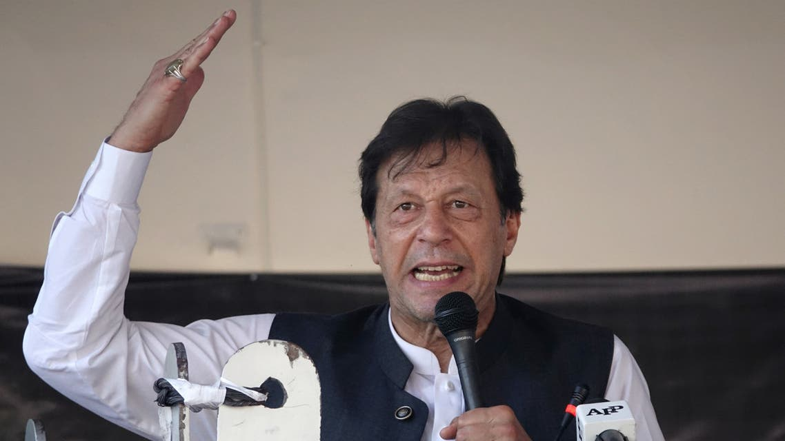 Pakistan's Prime Minister Imran Khan gestures as he speaks during a rally to express solidarity with the people of Kashmir, in Muzaffarabad, Pakistan-administered Kashmir, September 13, 2019. REUTERS/Naseer Chaudary NO RESALES. NO ARCHIVES