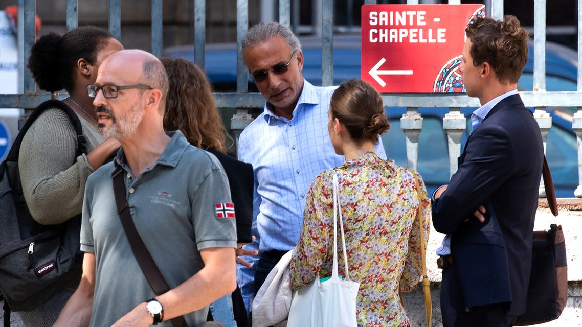 Swiss leading Islamic scholar Tariq Ramadan (C) speaks to a group of people as he leaves the Palais de Justice (Law Court) of Paris, on August 30, 2019 after a hearing. Tariq Ramadan, a leading Islamic scholar charged in France with raping two women, has also been accused of taking part in the gang rape of a journalist, French judicial sources said on August 25, 2019. The sources confirmed reports on Europe 1 radio and in Le Journal du Dimanche newspaper that a woman in her 50s had accused Ramadan, 56, of raping her along with a member of his staff when she went to interview the academic at a hotel in Lyon in May 2014.
