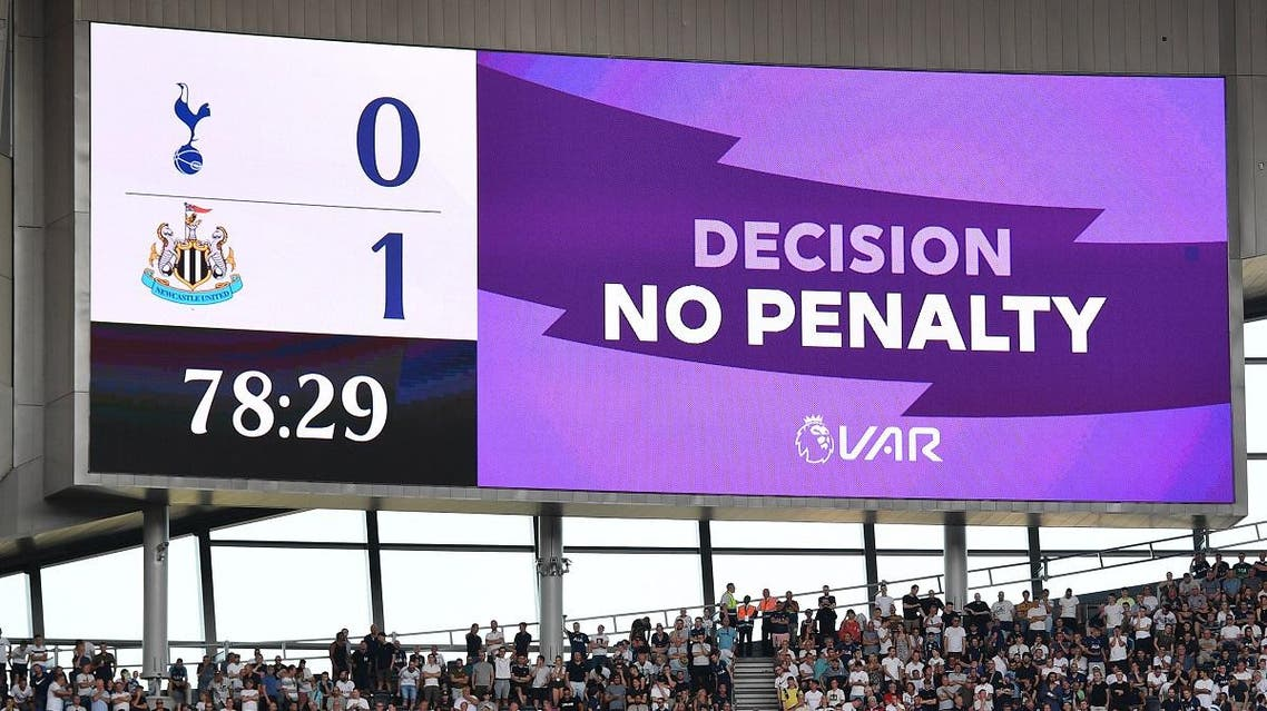 Tottenham Hotspur's English striker Harry Kane falls in the penalty area under a challenge from Newcastle United's English defender Jamaal Lascelles but after a VAR (Video Assistant referee) review no penalty is the decision shown on the scoreboard during the English Premier League football match between Tottenham Hotspur and Newcastle United at Tottenham Hotspur Stadium in London, on August 25, 2019. Daniel LEAL-OLIVAS / AFP