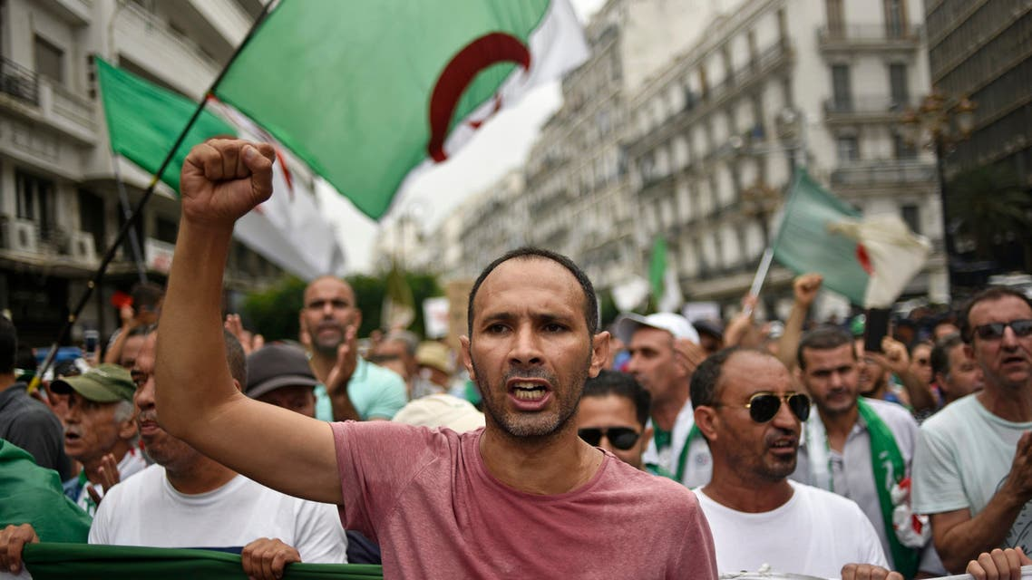 Algerian protesters wave their national flag, during a demonstration against the ruling class in the capital Algiers on September 13, 2019, for the 30th consecutive Friday since the movement began.