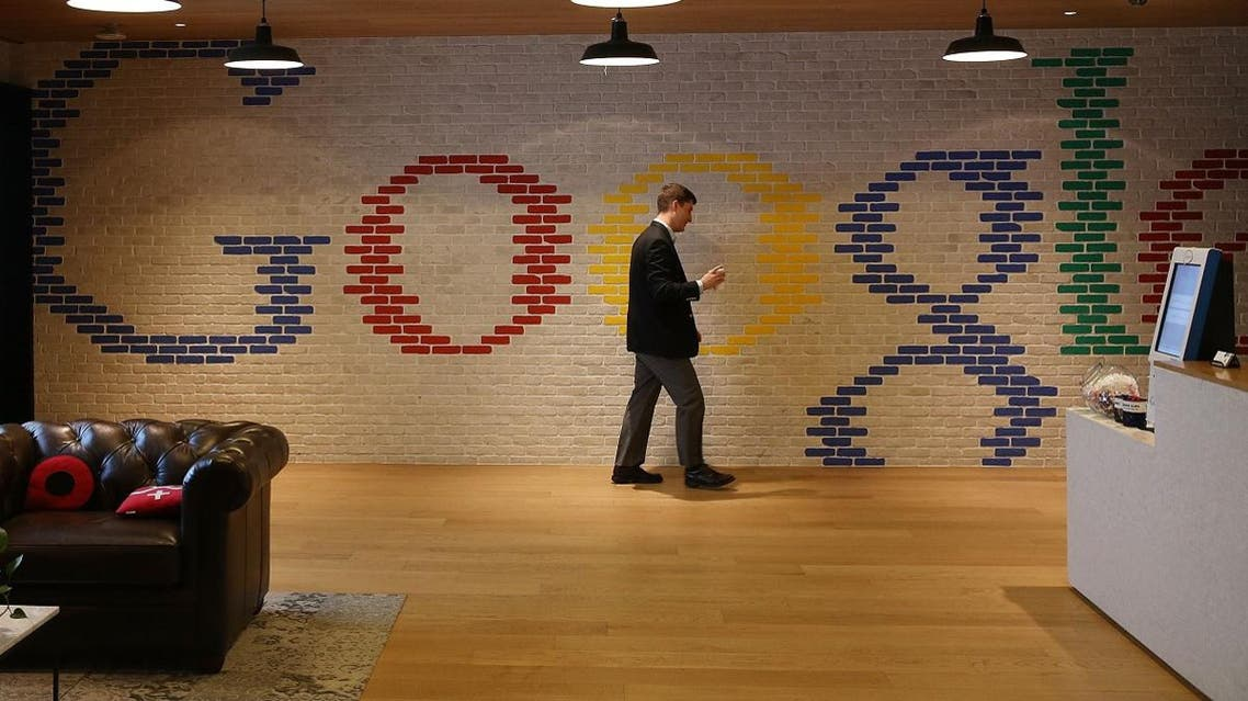 An employee walks through the lobby of Google's Washington headquarters. (File photo: AFP)