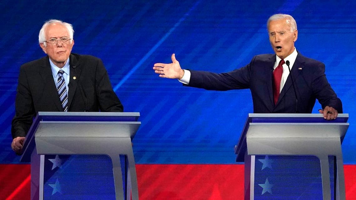 Former Vice President Joe Biden speaks as Senator Bernie Sanders listens during the 2020 Democratic U.S. presidential debate in Houston, Texas. (Reuters)