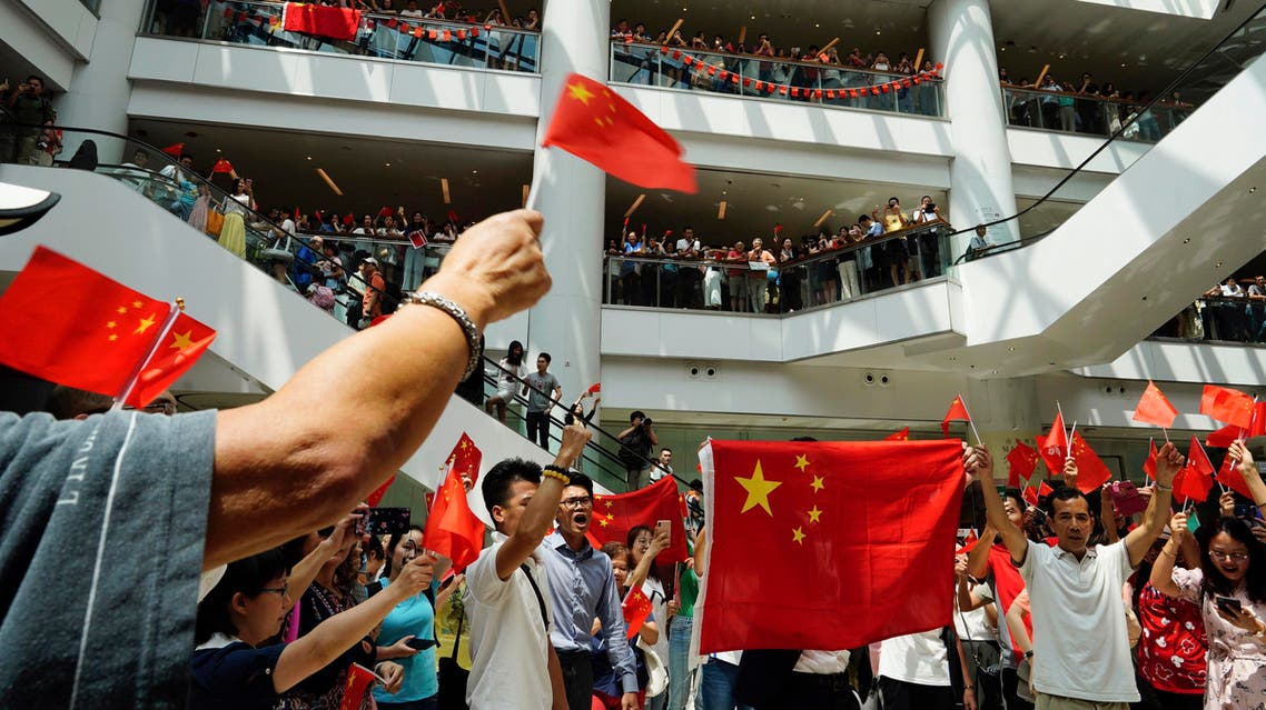 Pro-China protesters wave Chinese flags at a shopping mall in Hong Kong, Friday, Sept. 13, 2019. (AP)