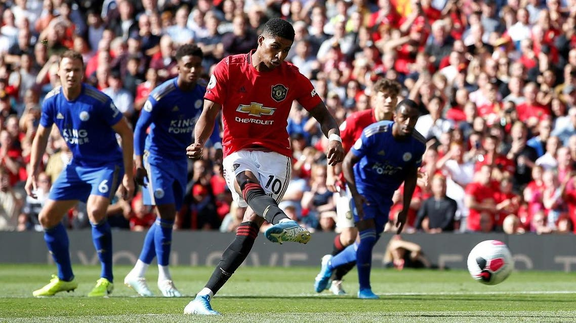 Manchester United's Marcus Rashford scores their first goal from the penalty spot. (Reuters)