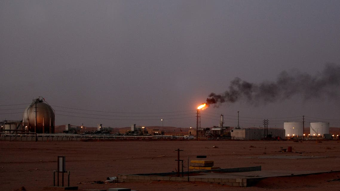 A flame from a Saudi Aramco (the national oil company) oil installation known as Pump 3 burns brightly during sunset in the Saudi Arabian desert near the oil-rich area Al-Khurais, 160 kms east of the capital Riyadh, on June 23, 2008. Deep in the Saudi desert, 28,000 Asian workers are racing to get a giant oil processing complex ready to help King Abdullah keep a vow to meet world demand for crude. AFP PHOTO/MARWAN NAAMANI