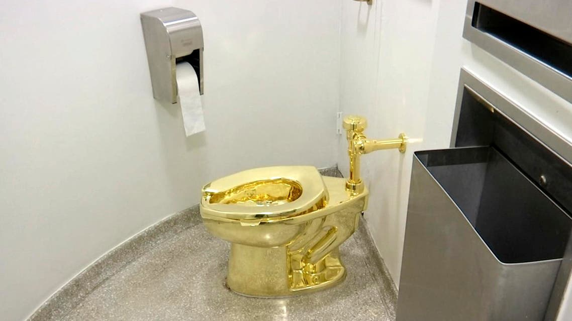 """This Sept. 16, 2016 file image made from a video shows the 18-karat toilet, titled """"America,"""" by Maurizio Cattelan in the restroom of the Solomon R. Guggenheim Museum in New York. (AP)"""