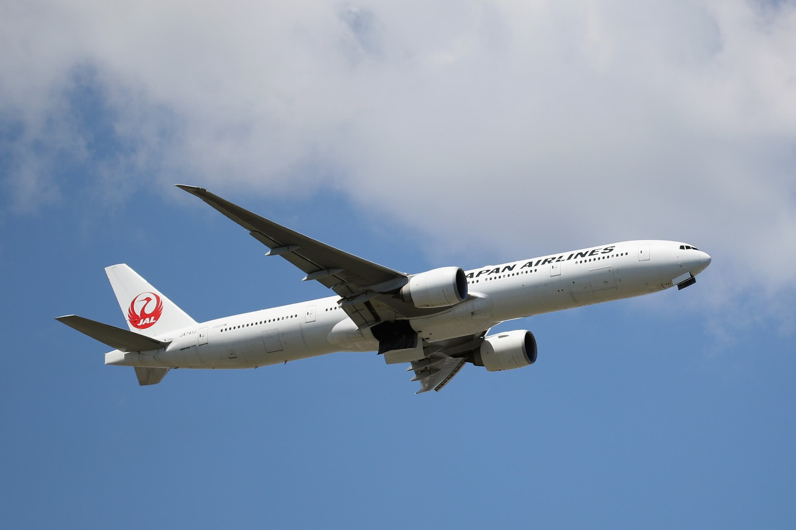A Boeing 777-346 (ER) operated by Japan Airlines takes off from JFK Airport on August 24, 2019 in the Queens borough of New York City. (AFP)