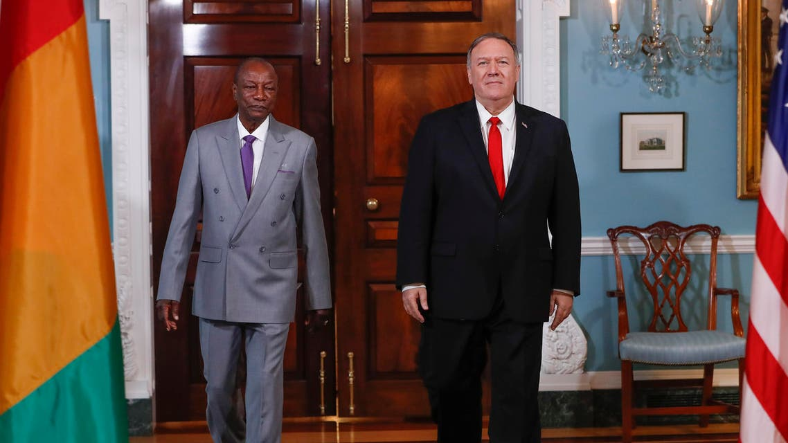 Secretary of State Mike Pompeo, right, walks with Guinean President Alpha Conde, left, at the State Department in Washington (AP)