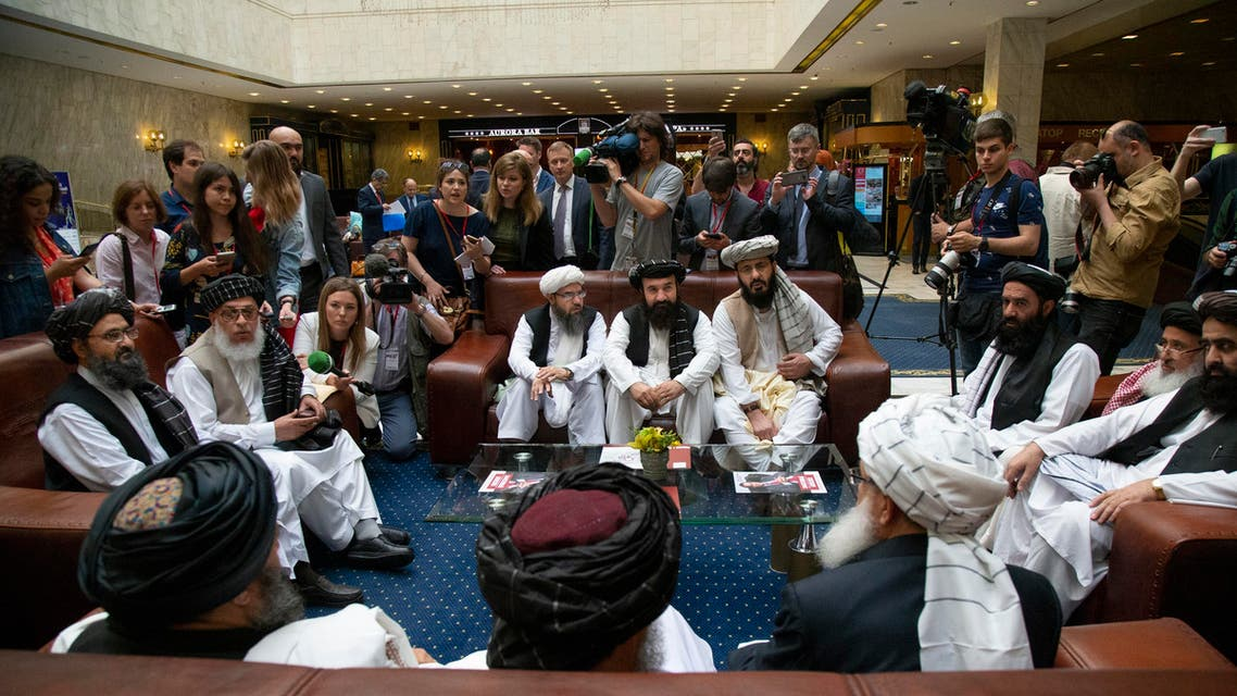 Mullah Abdul Ghani Baradar, the Taliban group's top political leader, left, Sher Mohammad Abbas Stanikzai, the Taliban's chief negotiator, second left, and other members of the Taliban delegation speak to reporters prior to their talks in Moscow, Russia. (AP)