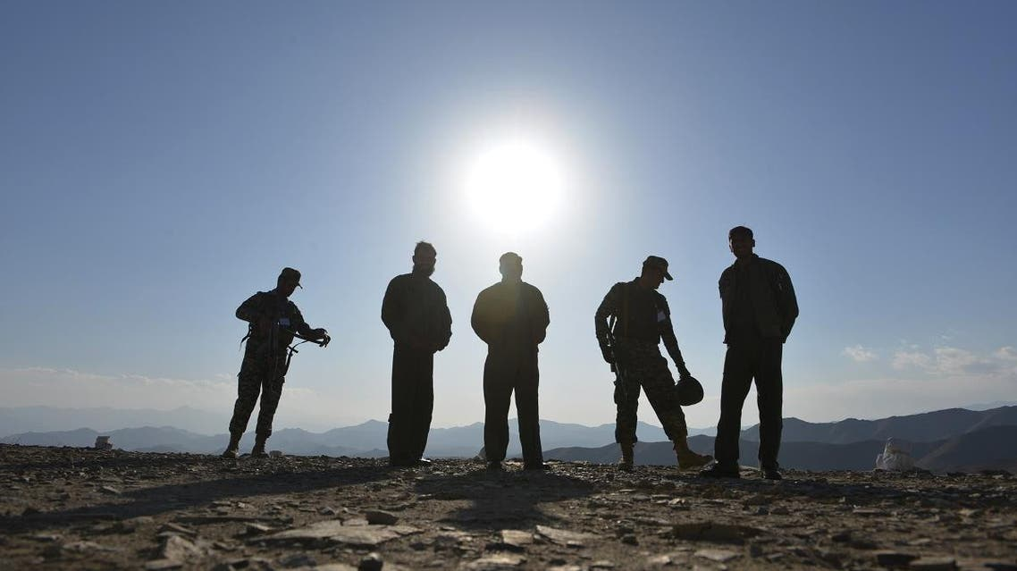 Pakistani army soldiers stand near a border terminal in Ghulam Khan, a town in North Waziristan. (AFP)