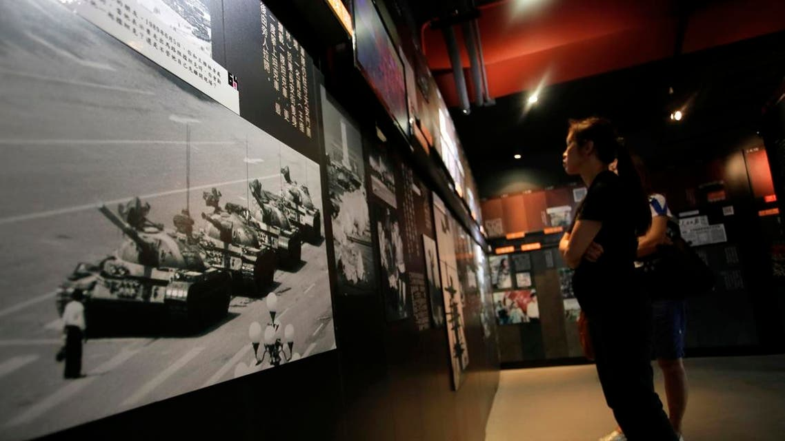 A photograph of Tank Man, the lone protester who stood to block the way of a line of several tanks during the 1989 pro-democracy movement in Beijing, is displayed at the June 4th Museum in Hong Kong. (AP)