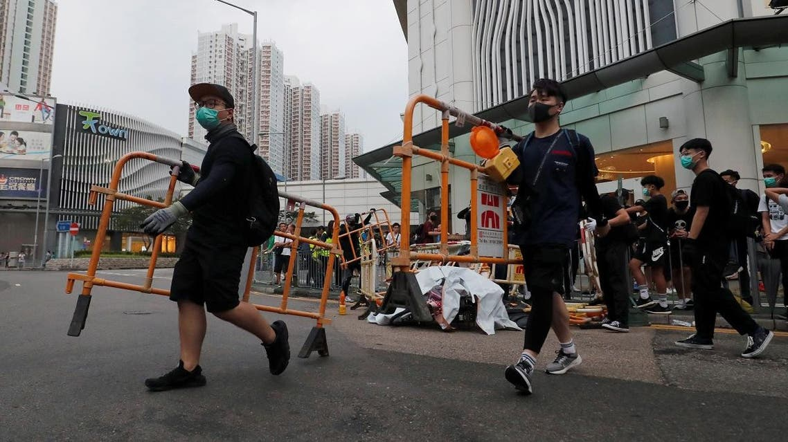 Anti-government protesters set up a roadblock during a demonstration in Tin Shui Wai in Hong Kong. (Reuters)