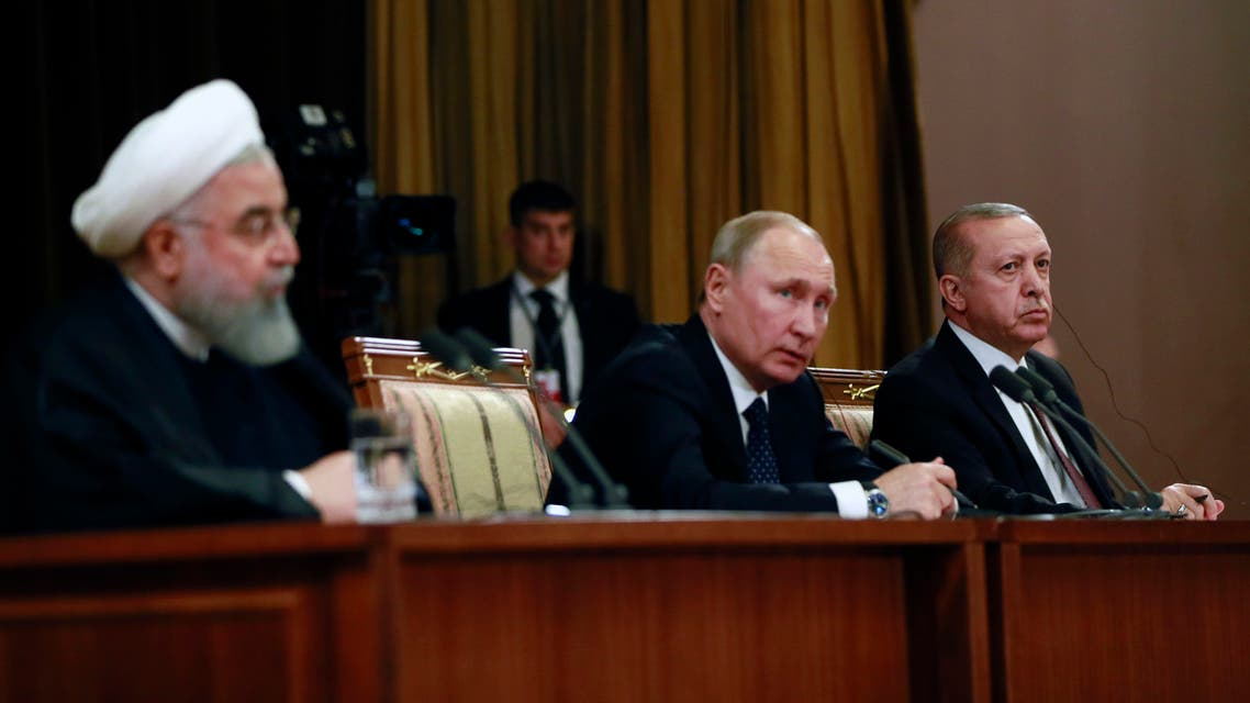 A handout picture taken and released on February 14 , 2019 by the Turkish Presidential Press service shows Iranian President Hassan Rouhani (L), Russian President Vladimir Putin (C) and Turkish President Recep Tayyip Erdogan (R) attending a press conference following a trilateral meeting on Syria in the Black Sea resort of Sochi. The leaders of Russia, Turkey and Iran met for talks on how to work more closely together in Syria as Washington prepares to withdraw its troops from the war-torn country. President Vladimir Putin hosted Turkish counterpart Recep Tayyip Erdogan and Iran's Hassan Rouhani for the talks in the southern city of Sochi.