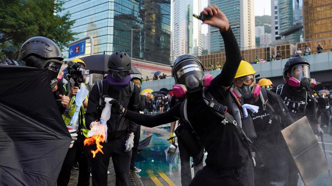 An anti-government protester throws a Molotov cocktail during a demonstration near Central Government Complex in Hong Kong on September 15, 2019. (AP)